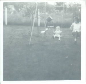 Alice baby on swing with Joann in Nanny's backyard